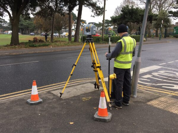 surveyor on roadside with trimble instrumentation for a topographical survey